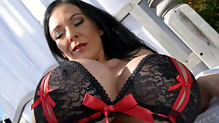 Milf Mistress in nylons posing and stripping in the garden