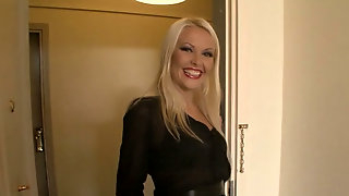 Tall blonde hooker is drilling her butt hole with fat dildo
